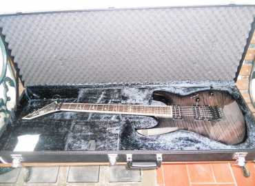 Photo: Sells Guitar ESP LTD DELUXE M-1000 - ESP LTD DELUXE M-1000