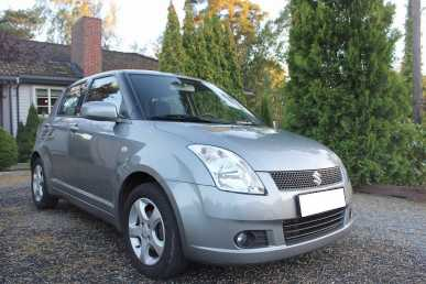 Photo: Sells Coupé SUZUKI - Swift