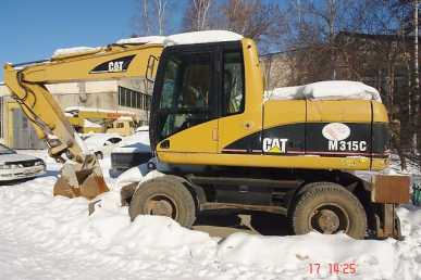 Photo: Sells Machine CATERPILLAR - M315C